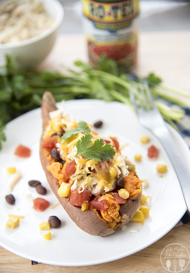 Southwest Stuffed Sweet Potatoes - These stuffed sweet potatoes are topped with black beans, corn, diced tomatoes, shredded chicken and cheddar cheese for a delicious healthier dinner or side dish!