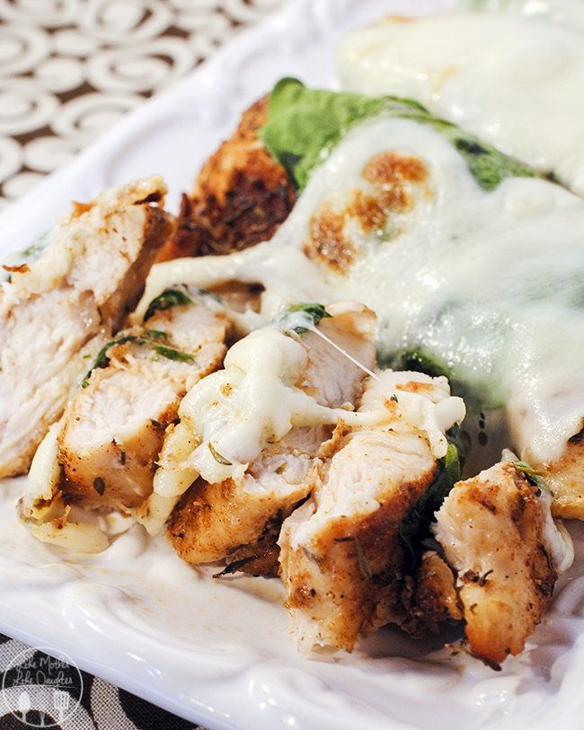 Roasted Jerk Chicken with Spinach Mozzarella Melt - this chicken is a hot hot main dish. Coated in a spicy jerk run, and topped with fresh spinach and ooey gooey mozzarella cheese.