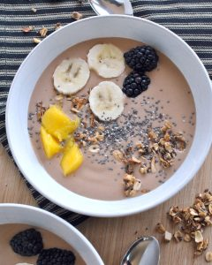 Chunky Monkey Smoothie Bowl takes your favorite flavor combination of chocolate, peanut butter, and banana to a new level, topping it all off with assorted fruits and granola or nuts or chia seeds. The answer to chocolate for breakfast.