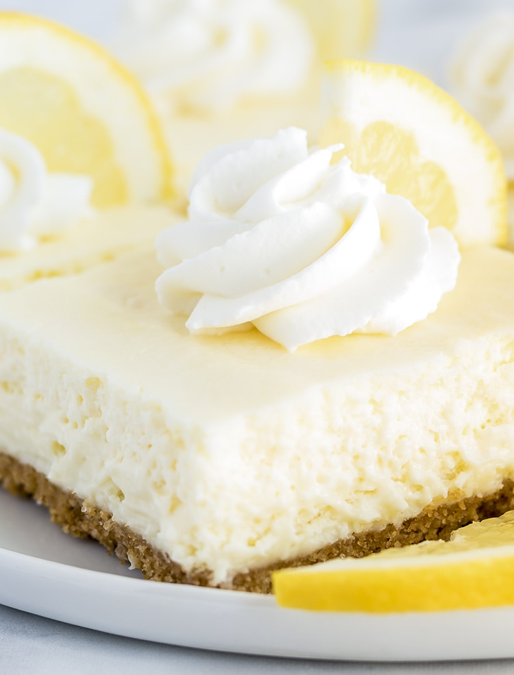 Lemon Cheesecake Bar with whipped cream on top