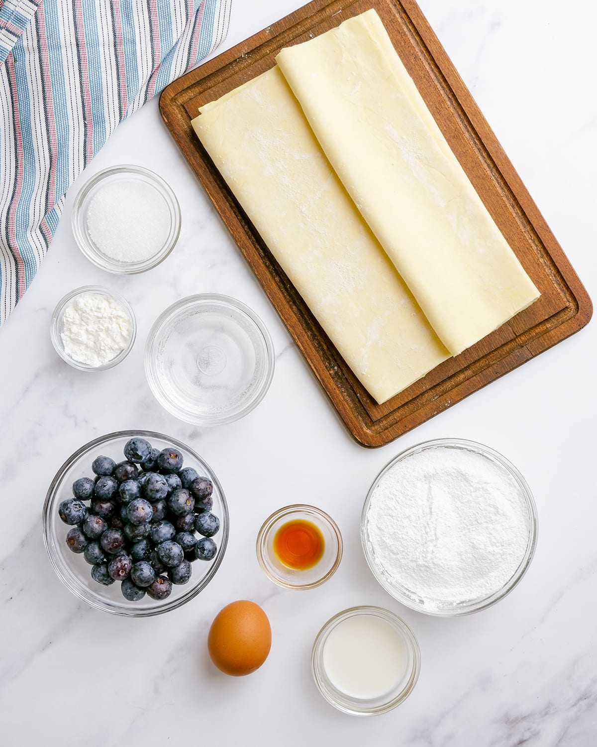 The ingredients needed to make blueberry turnovers.