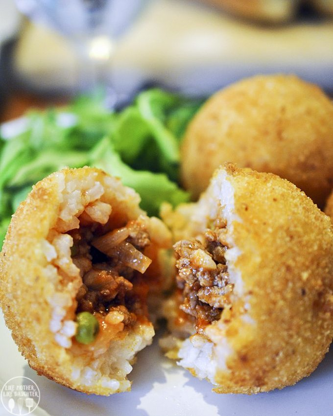 Arancini is the ultimate Sicilian and Italian food, its a delicious meat sauce stuffed inside a rice ball, dipped in bread crumbs and fried a ragu stuffed rice ball dipped in bread crumbs and deep fried.