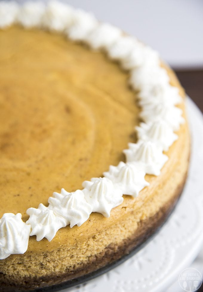 This pumpkin cheesecake combines two of the best flavors out there, cheesecake, and pumpkin pie into one delicious, and perfect for fall, dessert!
