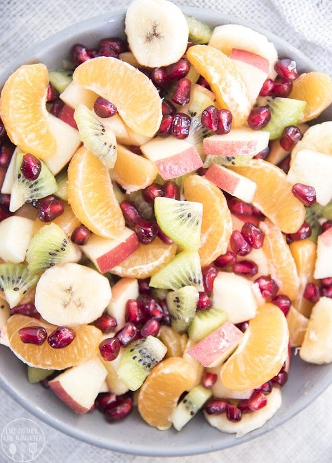 Winter fruit salad is loaded full of delicious winter fruits, like oranges, kiwi, pomegranates, and is perfect for a holiday party or dinner side dish.