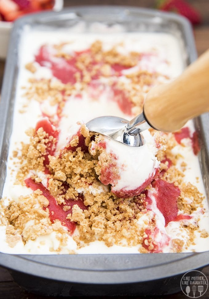 Strawberry cheesecake ice cream recipe with a creamy cheesecake ice cream base, and a sweet strawberry sauce and buttery graham cracker crust swirled throughout.