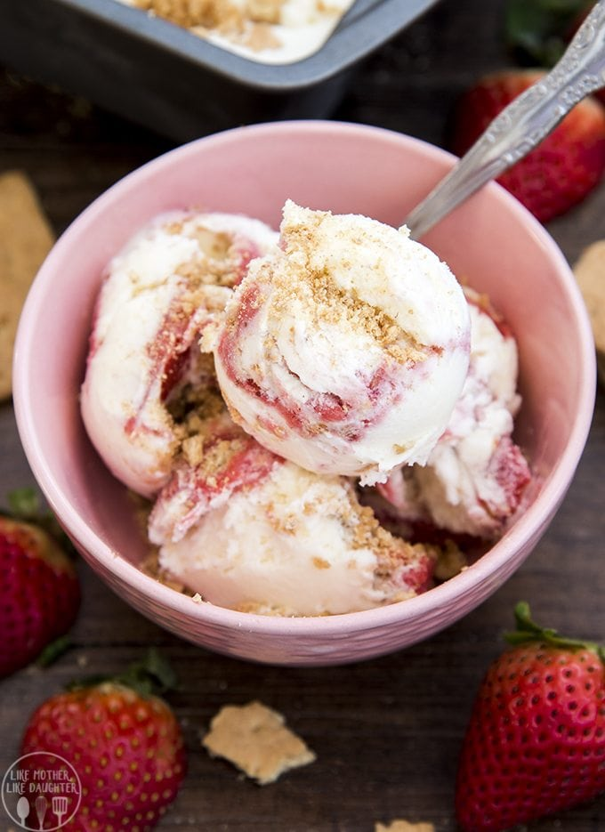 Homemade strawberry cheesecake ice cream with a creamy cheesecake ice cream base, and a sweet strawberry sauce and buttery graham cracker crust swirled throughout. Its like a delicious slice of strawberry cheesecake all wrapped up in a big bowl of ice cream!