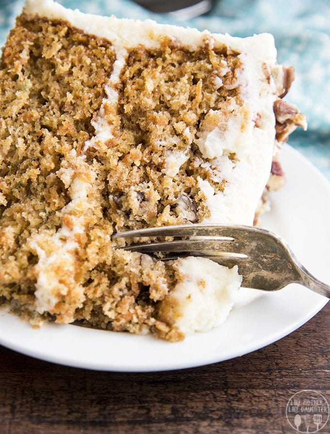 This layered carrot cake has two thick layers of moist, perfectly spiced carrot cake topped with the best cream cheese frosting. Everyone will be begging you for the recipe!