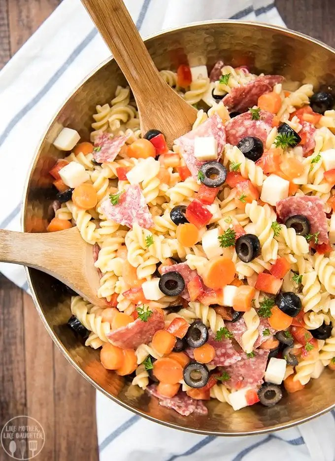 This pasta salad is full of delicious salami, cheese, fresh veggies and more for a perfect pot luck side dish!