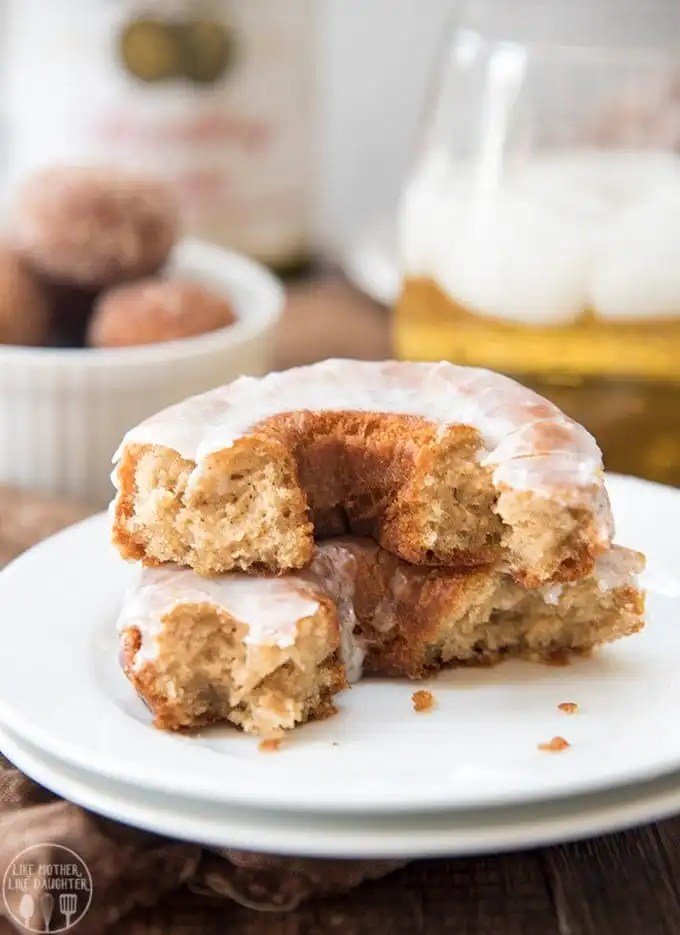 These apple cider donuts are a soft cake donut with a crunchy exterior. They are coated in a homemade apple cider glaze or cinnamon sugar for a perfect subtle apple cider and cinnamon taste in every bite.