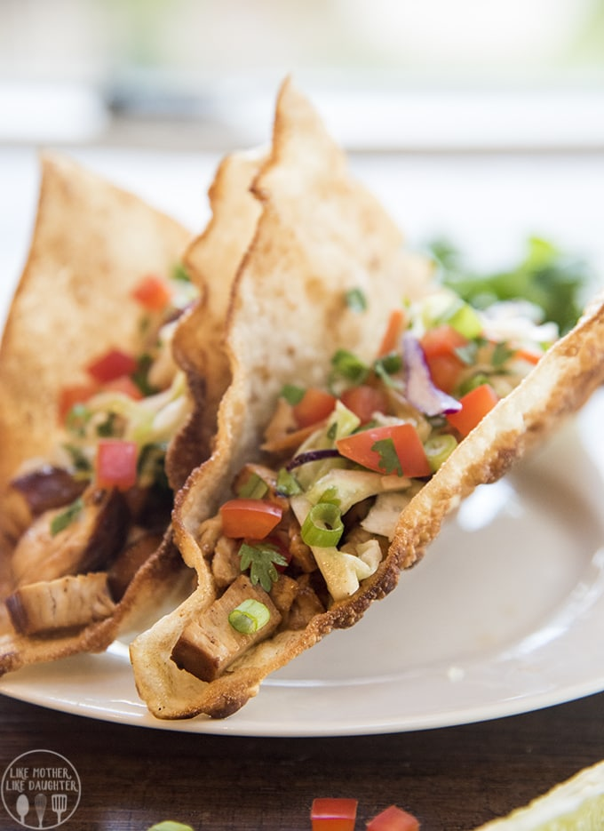 These teriyaki chicken tacos are perfection; with a crispy won-ton shell stuffed full of flavorful teriyaki chicken and topped with a tangy Asian slaw. You will want to make these again and again.