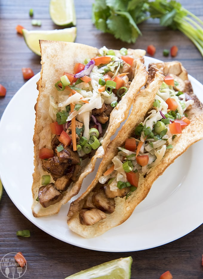 These teriyaki chicken tacos are perfection; with a crispy won-tonshell stuffed full of flavorful teriyaki chicken and topped with a tangy Asianslaw. You will want to make these again and again.