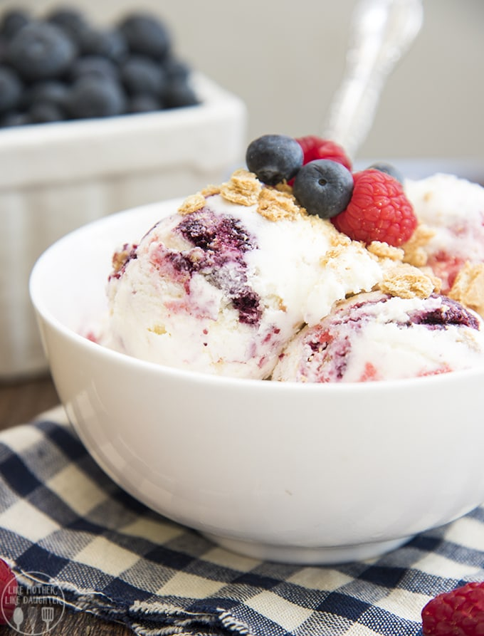 This homemade berry cheesecake ice cream tastes just like a slice of cheesecake. With rich cheesecake ice cream, swirled with graham cracker crust crumb and  blueberry and raspberry sauces. This ice cream is a dream come true for cheesecake lovers.