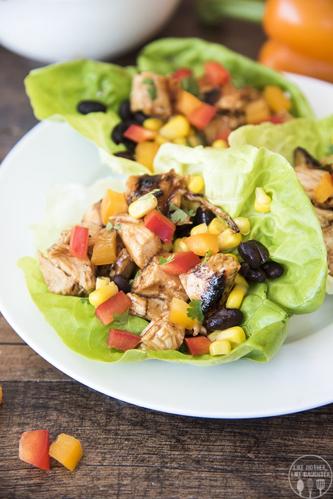These barbecue chicken lettuce wraps are easy to make and packed full of flavor. Stuffed full of bbq chicken, corn, black beans, and bell peppers these are perfect for lunch or dinner!