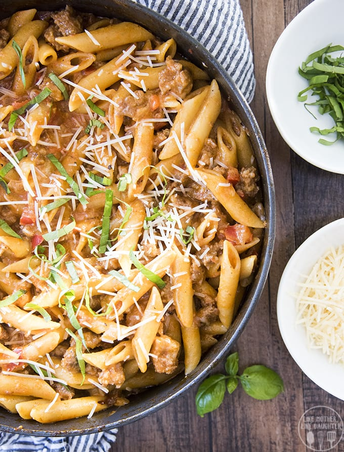 One pot sausage pasta is a delicious and hearty pasta dish packed full of flavor with a creamy marinara sauce, penne noodles and sausage, perfect topped with fresh basil and parmesan cheese!!