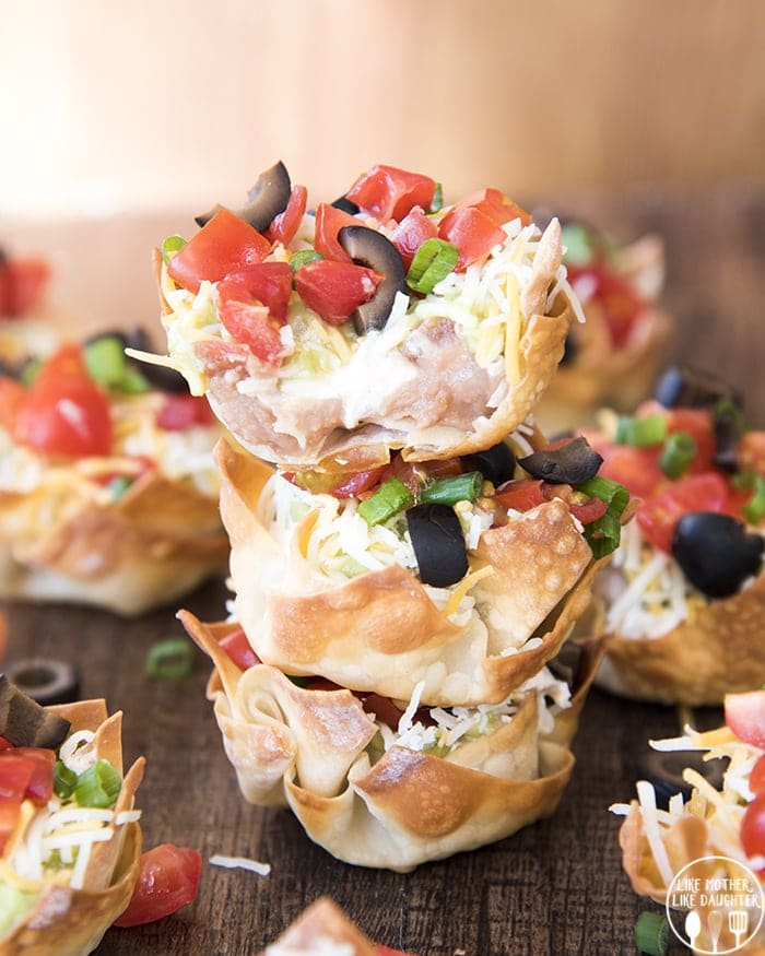 7 layer bean dip in a wonton cup shell!
