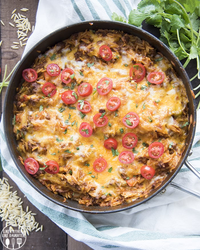 >One Pot Cheesy Taco pasta is a delicious one pot dish that is ready in about 30 minutes, perfect for a taco flavored dish with orzo pasta, salsa, ground beef, and lots of cheese.