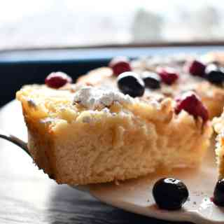 Lemon ricotta cake with the perfect deliciousness of creamy ricotta, tart lemon curd, and sweet cake baked together