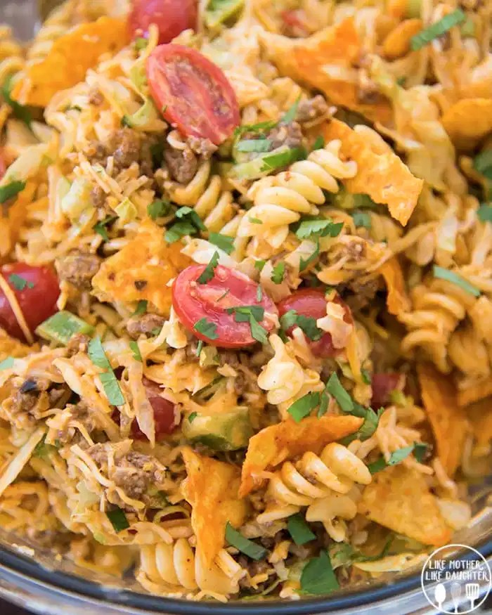 Taco Pasta salad with tomatoes, ground beef, crunchy Doritos and more!