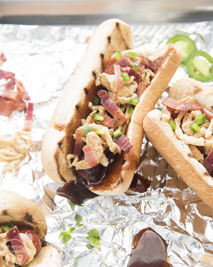 Bacon topped bbq hot dogs