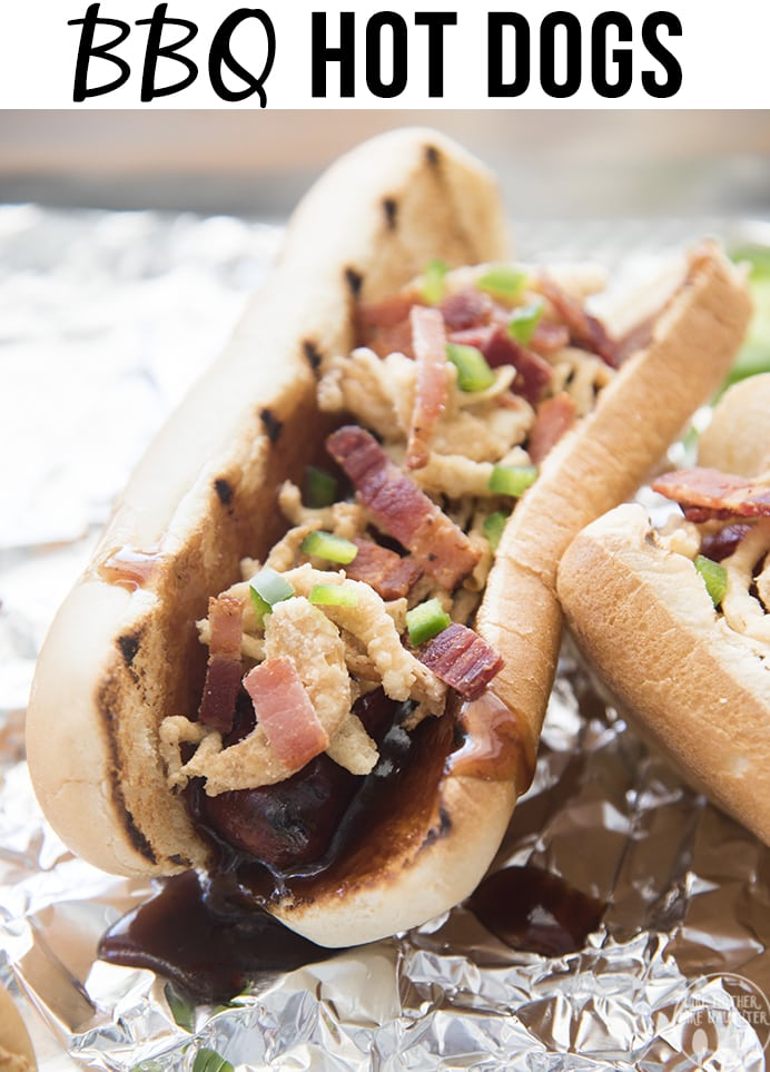 These BBQ Hot Dogs are topped with tangy BBQ sauce, crispy onion straws, salty bacon, and spicy jalapenos for a delicious twist that is perfect to eat all summer long!
