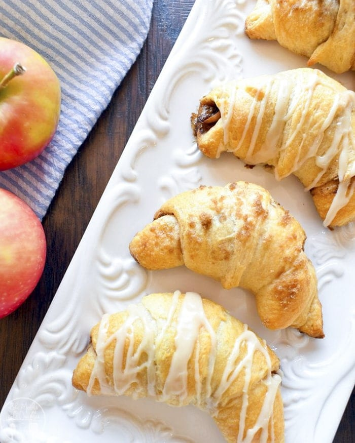 These apple pie crescents are a quick and easy way to enjoy the flavors of apple pie with buttery cinnamon apples all topped with a maple glaze!