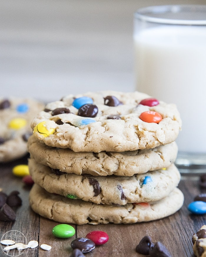 These monster cookies are a thick soft and chewy peanut butter and oatmeal cookie packed full of colorful m&ms and chocolate chips for a fun and delicious cookie everyone loves!