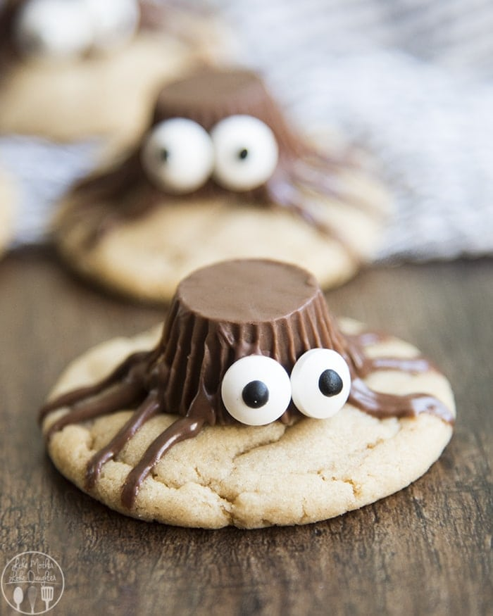 These peanut butter spider cookies are chewy and soft peanut butter cookies topped with a cute peanut butter cup spider! Perfect for a fun and adorable Halloween treat!