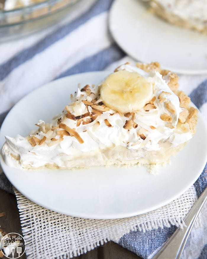 This banana coconut cream pie starts with a buttery shortbread crust, topped with banana slices, and a creamy custard filled with toasted coconut, all topped with whipped cream - it's a delicious mash up of two delicious pies that everyone will love!