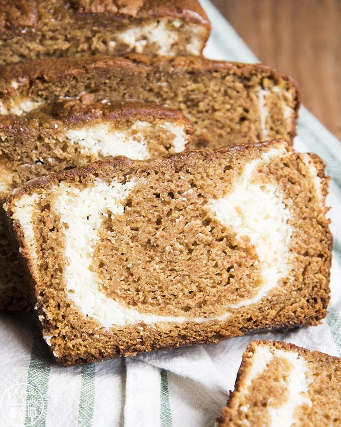 This pumpkin cream cheese bread is a a delicious and moist pumpkin bread that has a sweet swirl of cream cheese in the middle. It's the perfect fall dessert!