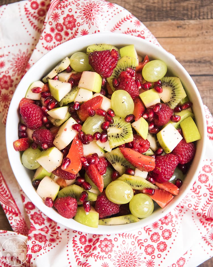 Red and Green Fruit salad with grapes, apples, kiwi, pomegranates, strawberries and raspberries