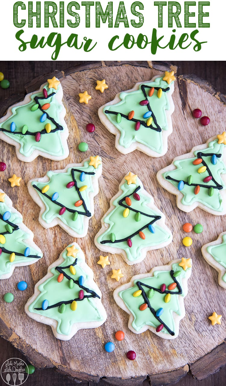 These Christmas Tree Sugar Cookies are easy and adorable tree shaped sugar cookies decorated with mini M&ms as Christmas lights. Perfect for the Christmas season!