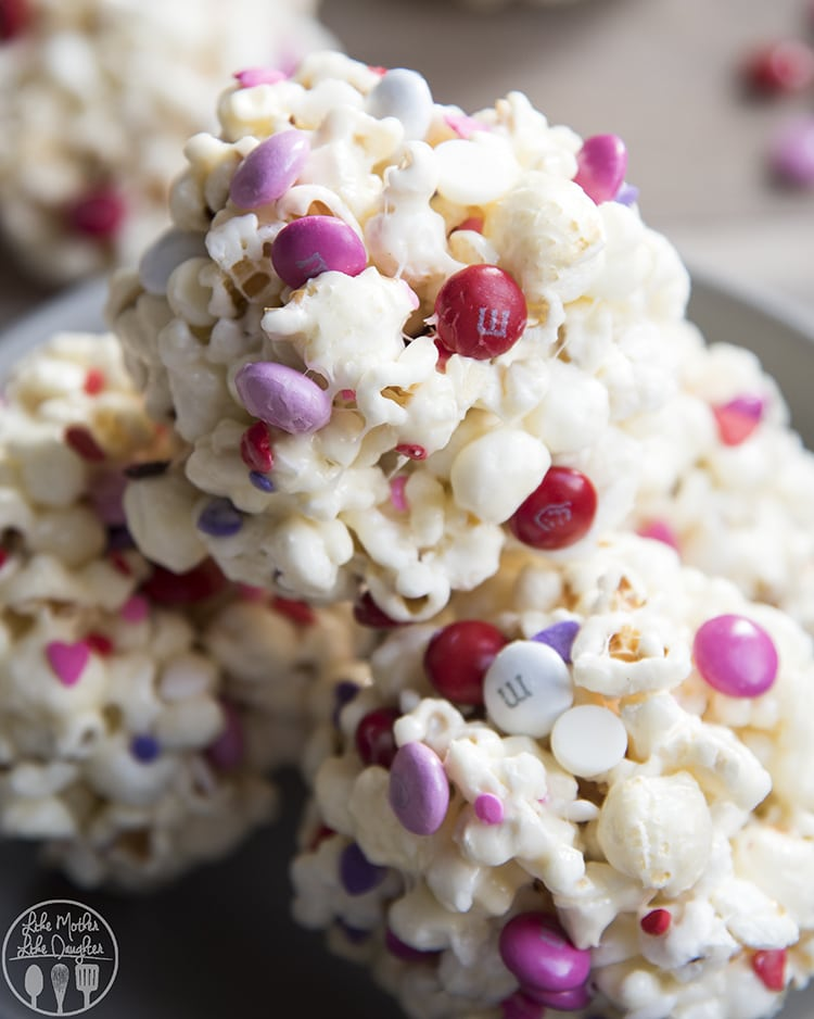 Valentine's Day Popcorn Recipe rolled into cute handheld popcorn balls