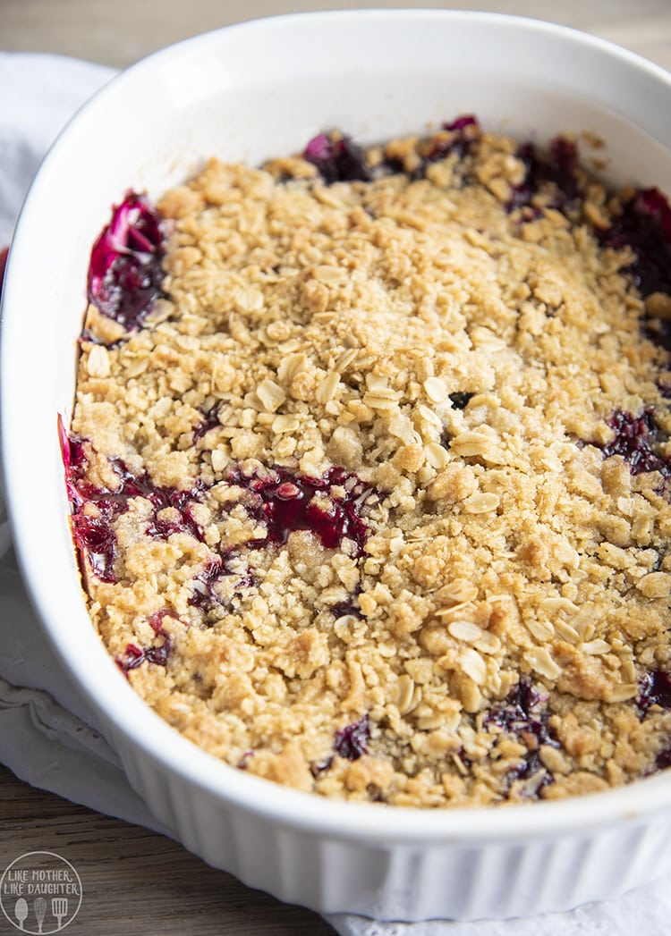 A pan of berry crisp with oatmeal crumble topping