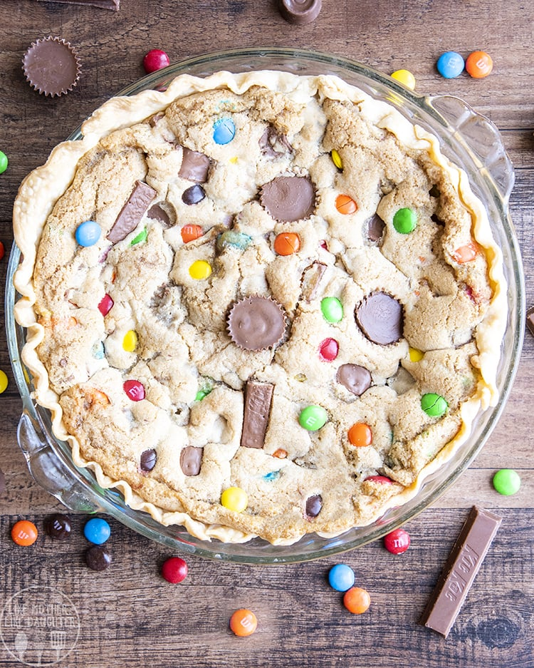 Candy Bar Pie with a pie crust, and a cookie filling stuffed with chocolate