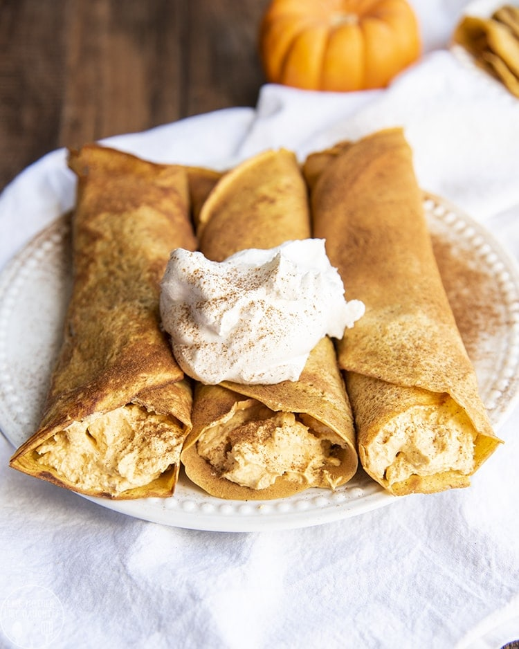 These pumpkin crepes are delicious light and golden crepes, flavored with actual pumpkin and pumpkin spice for the perfect fall breakfast. Stuffed full of pumpkin cheesecake for a perfect fall brunch or breakfast.