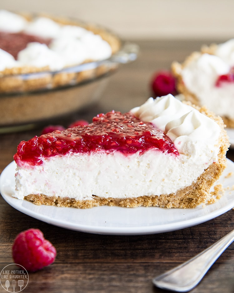 Raspberry Cream Pie with a graham cracker crust, no bake cheesecake filling, topped with fresh raspberry sauce and whipped cream