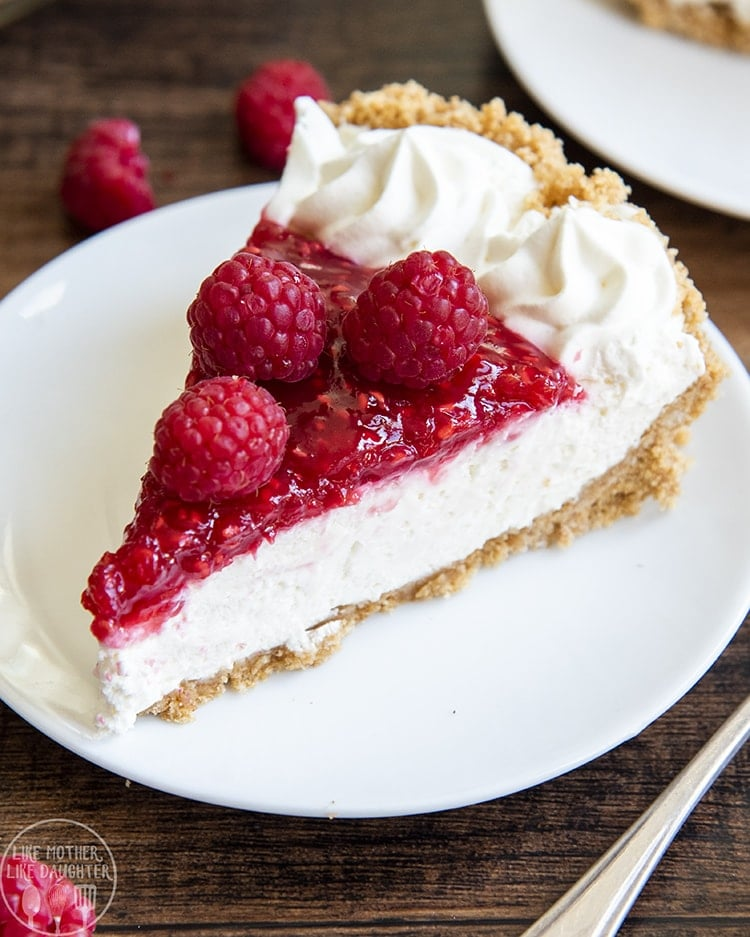 This sweet raspberry cream pie has a buttery graham cracker crust, smooth cream cheese base, topped with a sweet raspberry topping. It's perfect any time of the year, but especially for Thanksgiving!
