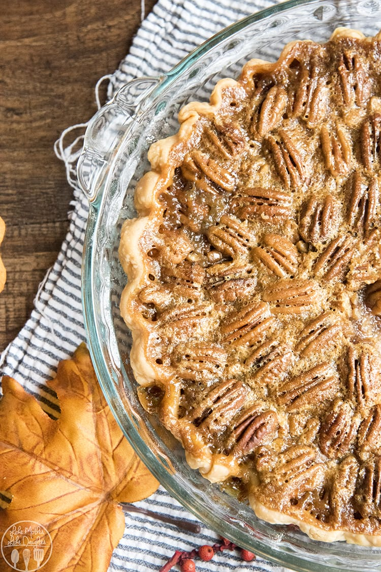 A buttery sugary pecan pie with crispy pecans
