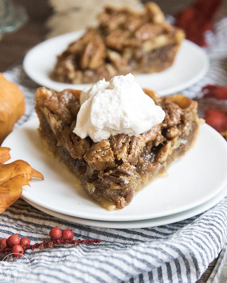 Pecan Pie is a classic American pie with a gooey sugary buttery filling topped with crispy pecans. One bite and you'll want it to be on the Thanksgiving menu every year!
