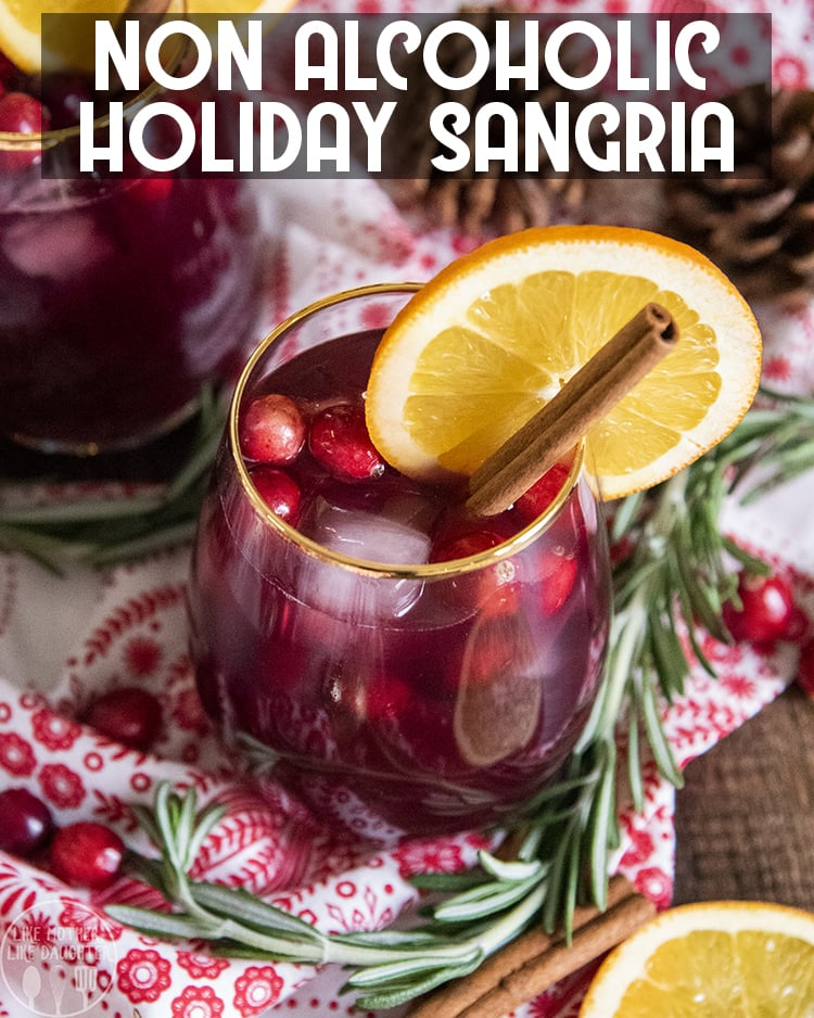 This non alcoholic Christmas sangria is the perfect holiday drink packed with fresh cranberries, and orange slices, it's a great holiday party drink, or even for Christmas dinner!