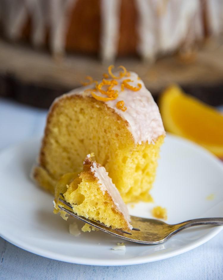 A slice of orange cake on a plate