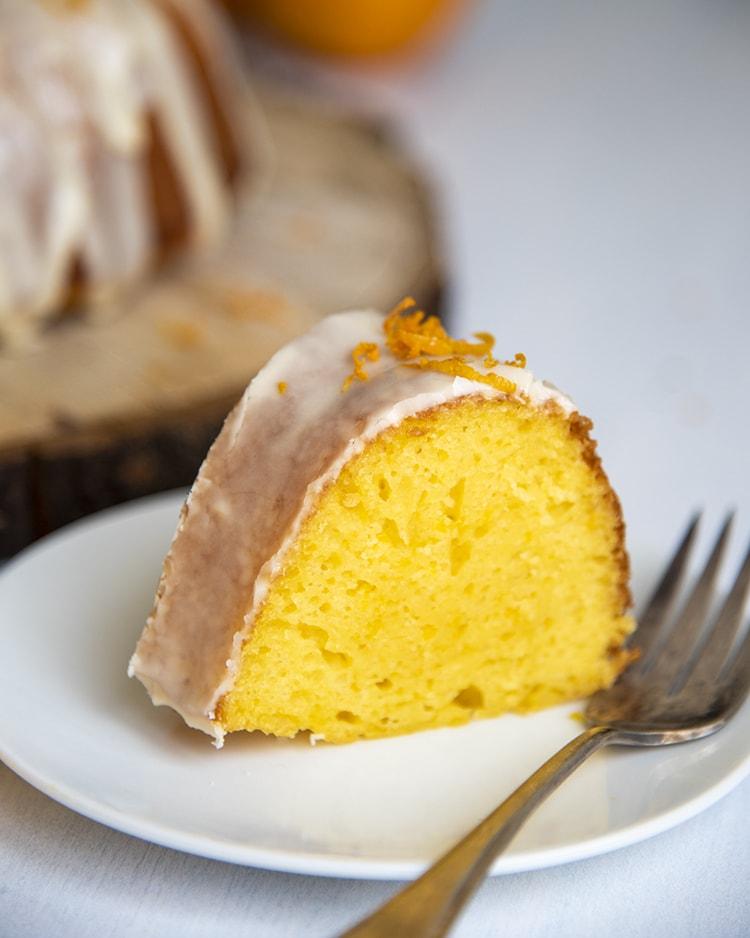 A slice of orange bundt cake made with a cake mix