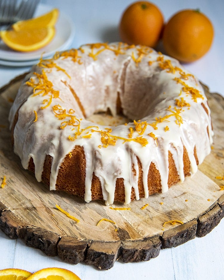 This orange bundt cake is so easy! It's made with a yellow cox cake mix with just a few extra ingredients added. The extra ingredients make this cake extra moist, extra flavorful, and extra delicious.