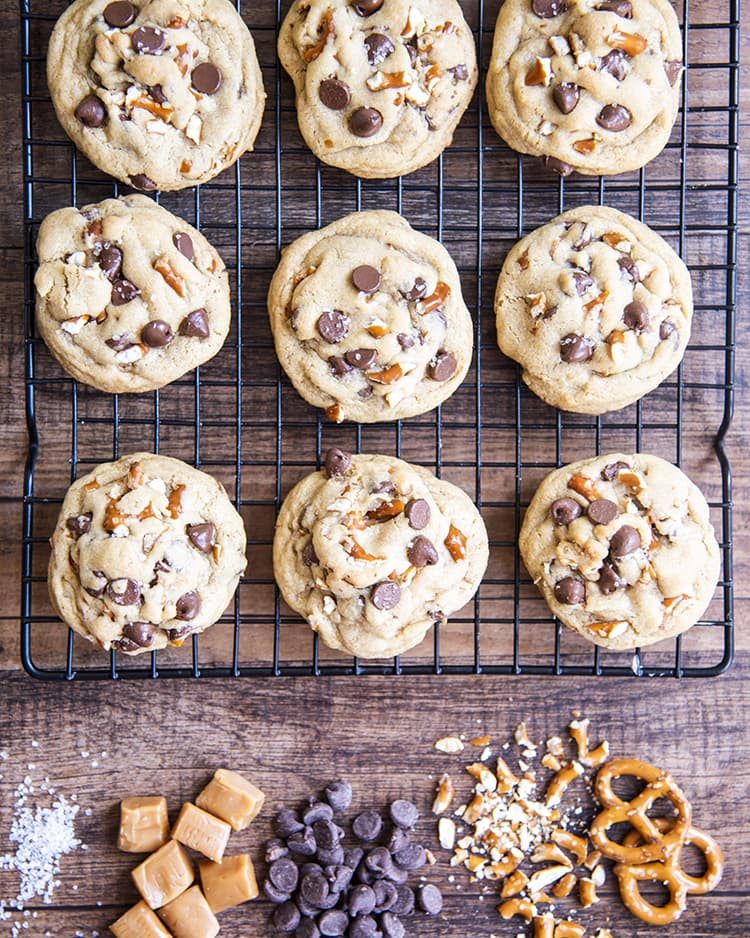 Cookies with chocolate chips, pretzels and sea salt on a cooling rack
