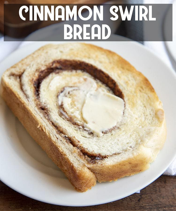A piece of cinnamon swirl toast with butter on top on a white plate with text overlay for pinterest