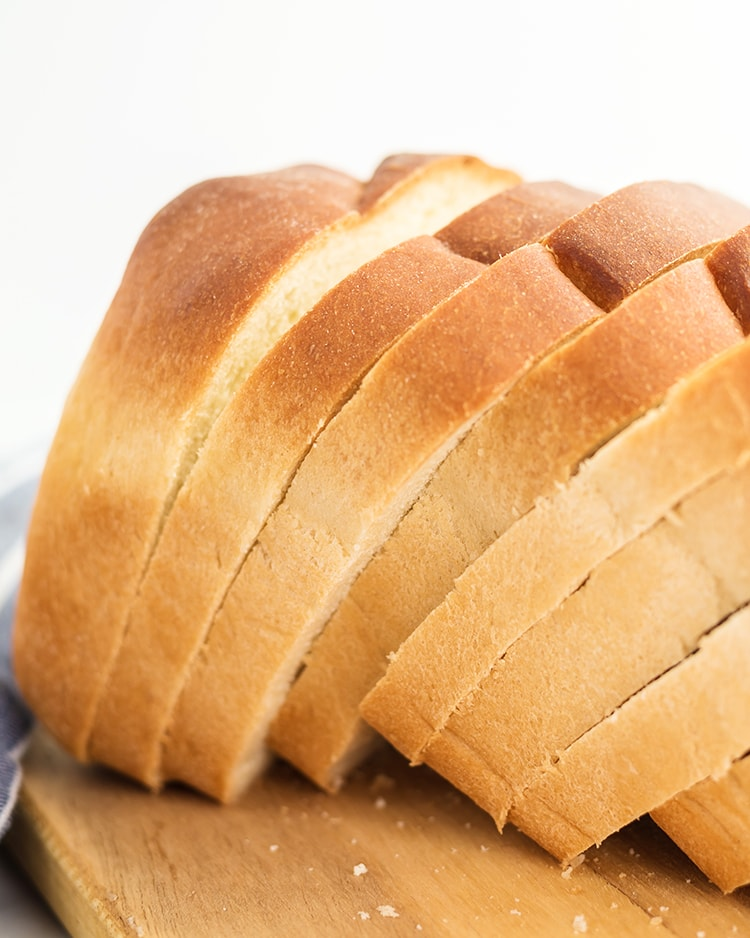 A loaf of white bread sliced up