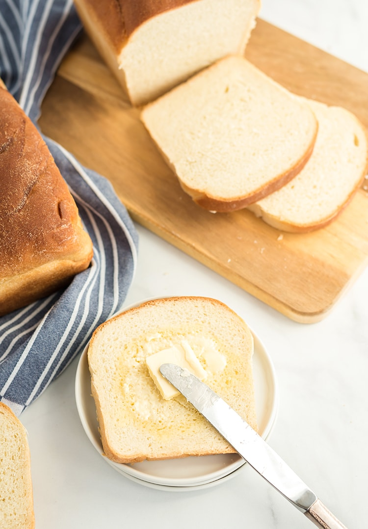 Homemade white bread on a plate with butter