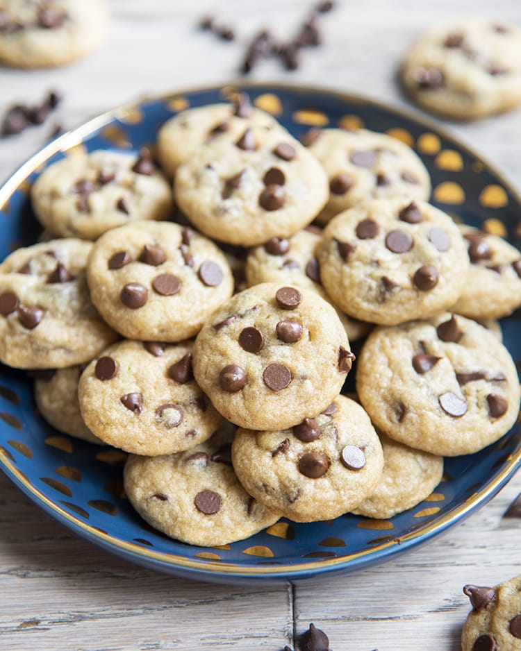 A blue plate full of mini chocolate chip cookies