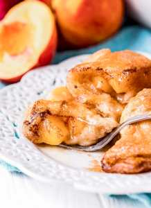 Peach Dumplings on a plate being cut by a fork