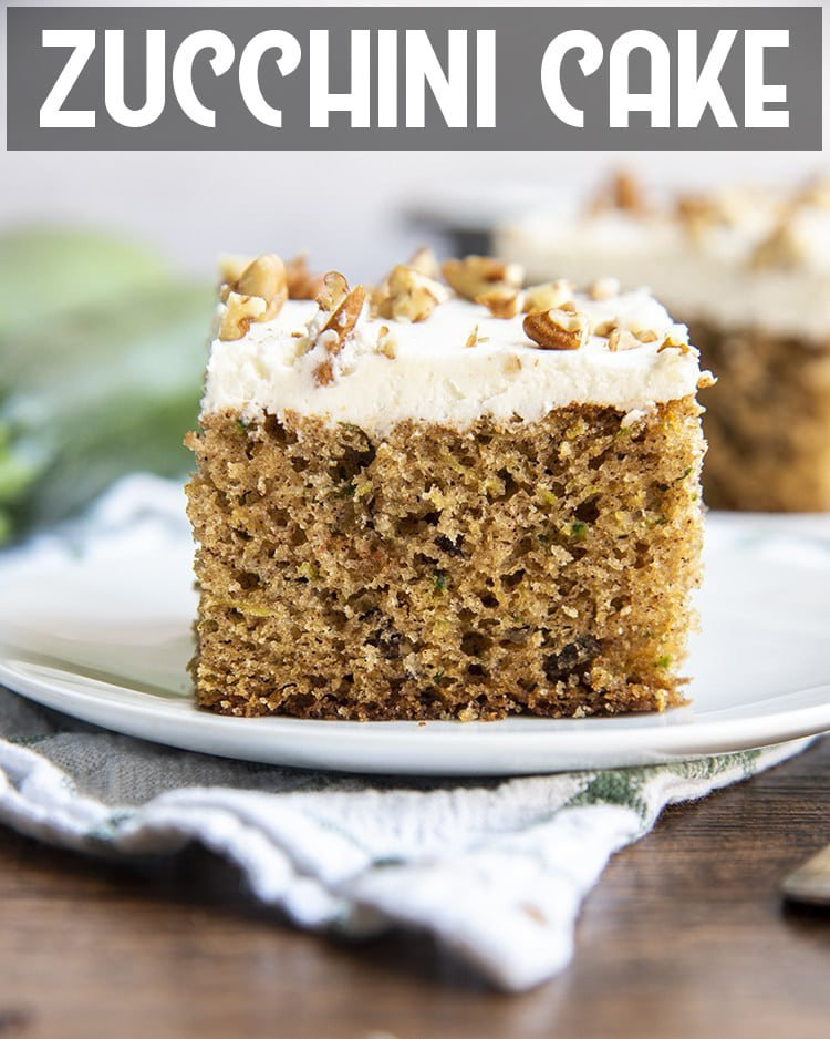 A slice of zucchini cake with cream cheese frosting on a plate with text overlay for pinterest.